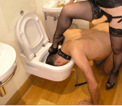 Slave's Head Being Flushed Down Toilet