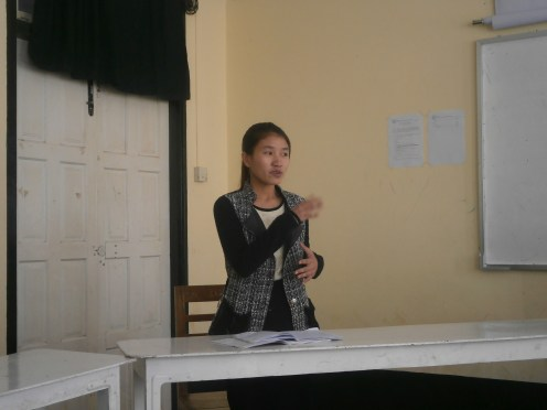A student raising her Point of Information in the middle of Debate