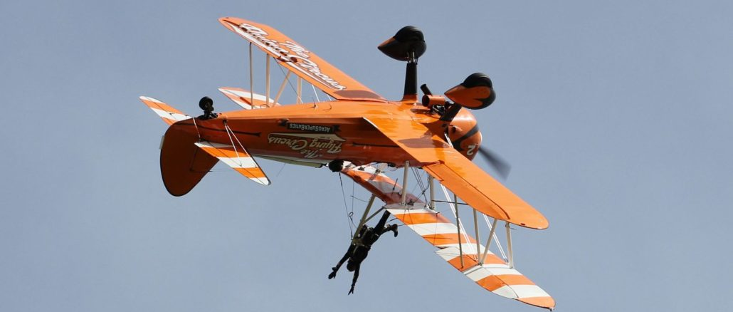 Seeing the world upside down is all in a days work for a wingwalker. (Image : The Aviation Media Co.)
