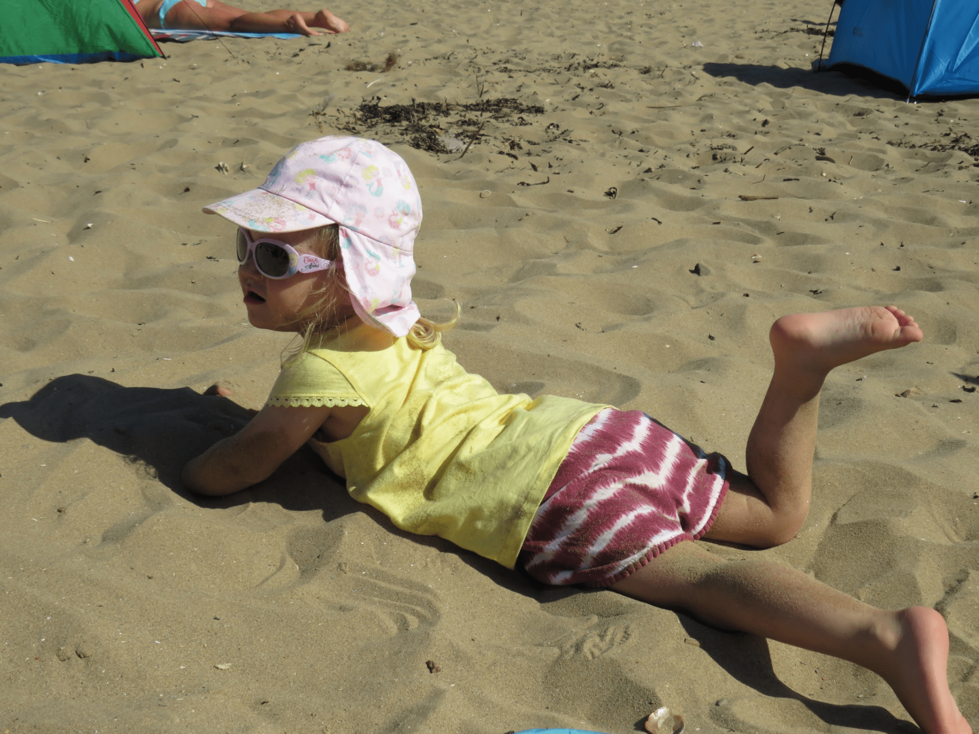Ha yes you can cover me in suncream mum but then I'm going to make a sand angel and cake myself in sand!