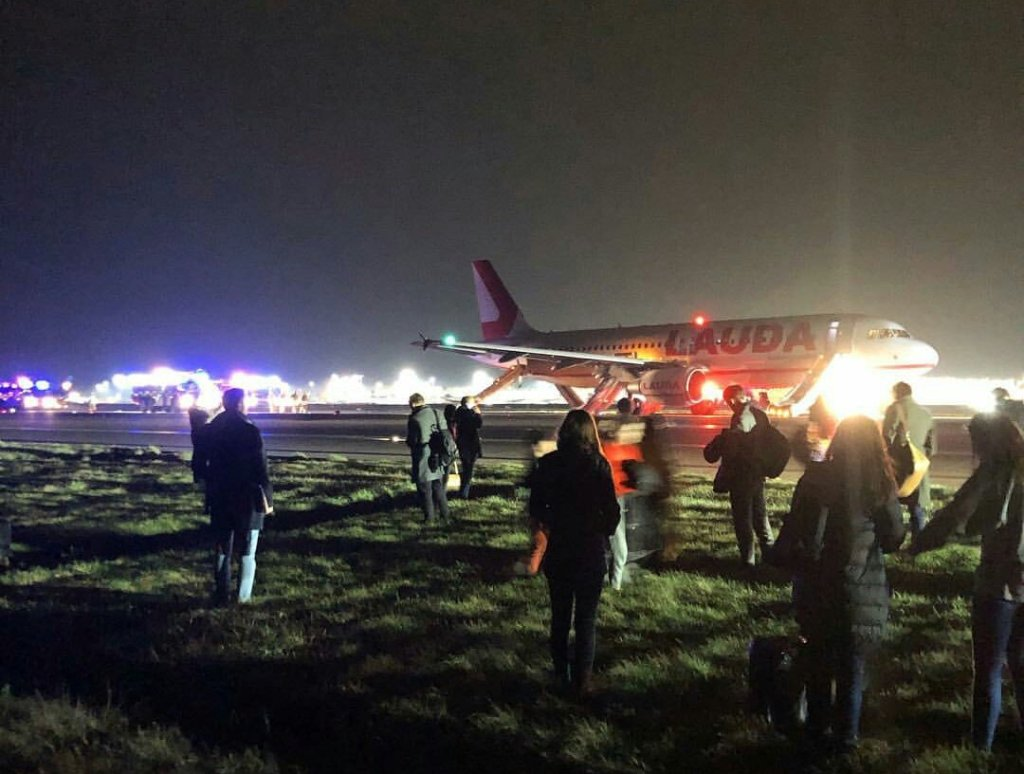 Another image shared widely on Social Media shows passengers evacuated from both sides of the aircraft (Image: Origin Unknown/Twitter)