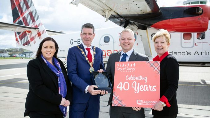 City of Derry Airport manager Charlene Shongo, Derry Mayor John Boyle, Loganair managing director Jonathan Hinkles, Loganair commercial director Kay Ryan in front of Twin Otter.