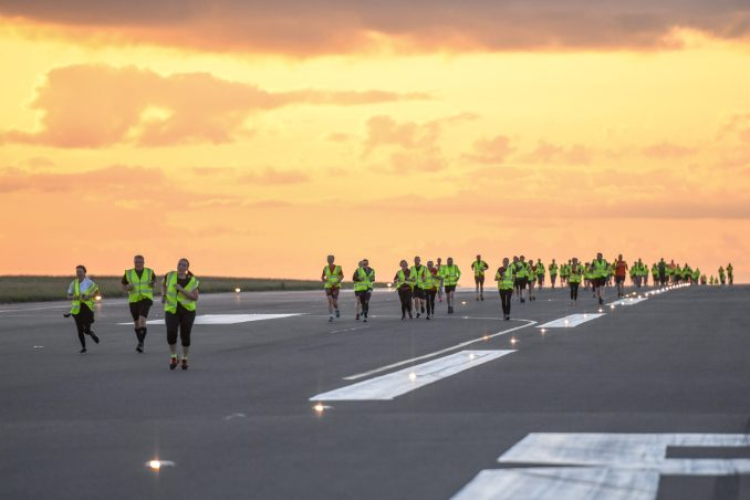 Hundreds run on Luton Airport's runway for Macmillan Cancer Support