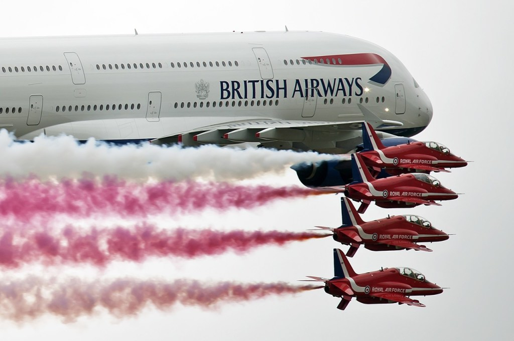 British Airways A380 flies with the Red Arrows