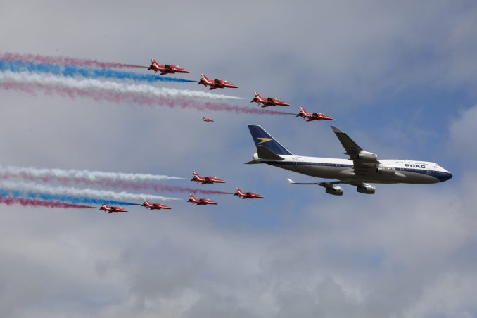 The Red Arrows performed a flypast with a British Airways Boeing 747 over the Royal International Air Tattoo.