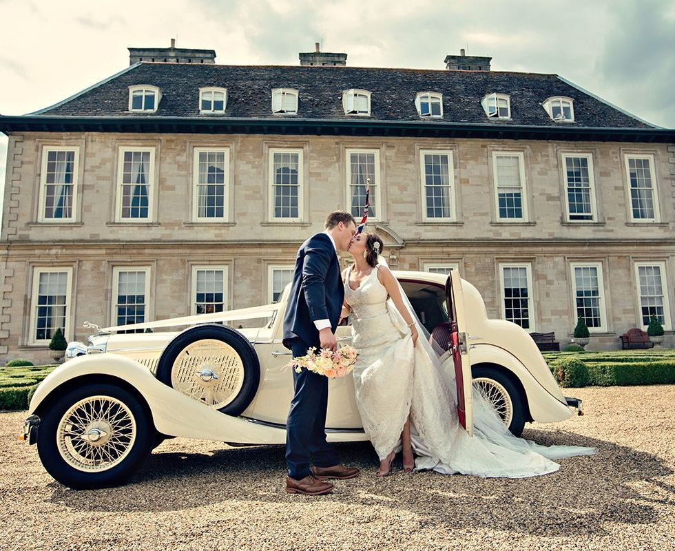Kate and Adam kissing through the car at this Leicestershire venue.