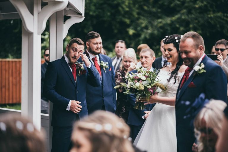 A shot of the groom sobbing as his bride walks down the aisle always feels moving, and OWO Photography have done a great job of capturing this one!