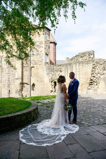 The couple standing outside Newcastle's Castle!
