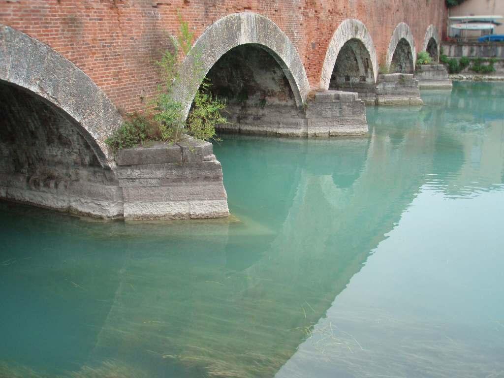 a river flowing under a briidge