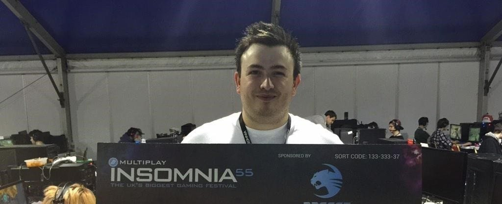 Luke with a big cheque at Multiplay's i55.