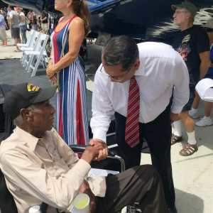 Supervisor V. Manuel Perez with a veteran at a Memorial Day ceremony in 2017.