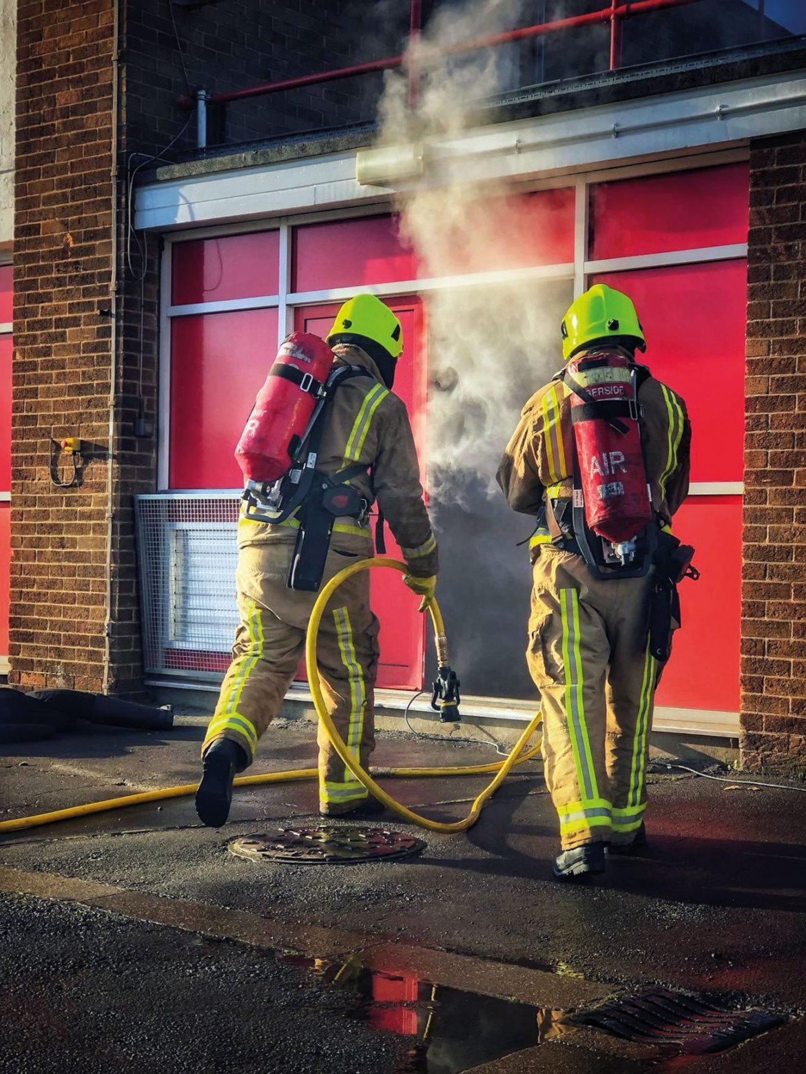 Full-Time firefighters maintaining their competence in the Breathing Apparatus Training Facility.