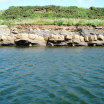 Back of the bathing pool with tilting sandstone strata