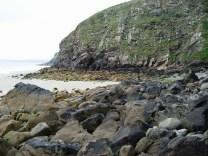 Carboniferous sandstone cliff and boulders