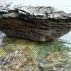 Weathered rock with clear water