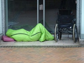 homeless-person-sleeping-in-doorway