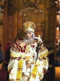 The body of His Holiness Pope Shenouda III placed on his throne in St. Mark's Cathedral during the Sunday Divine Liturgy following his departure