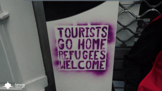 tourists go home, refugees welcome