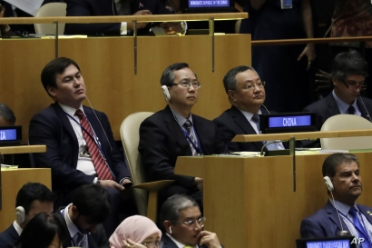 Members of China's U.N. delegation listen to President Donald Trump deliver remarks to the 74th session of the United Nations General Assembly, in New York, Sept. 24, 2019.