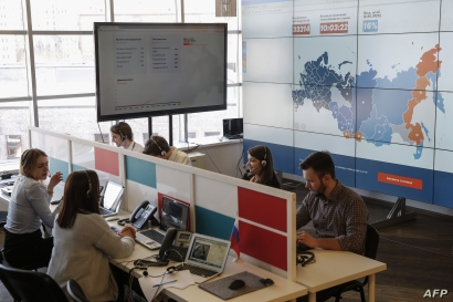 FILE - Activist supporters of Kremlin critic Alexei Navalny are seen monitoring elections at the office of Navalny's Anti-Corruption Foundation (FBK), in Moscow, Russia, March 18, 2018.
