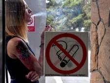 Штука баксов штрафа за курение у себя дома