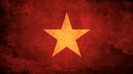 Vietnam-Flag-on-Red-Grunge-Wall