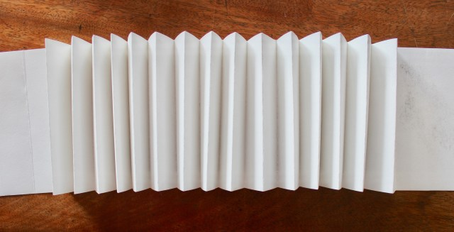 I fold paper in concertina fashion to form the spine of the sketchbook