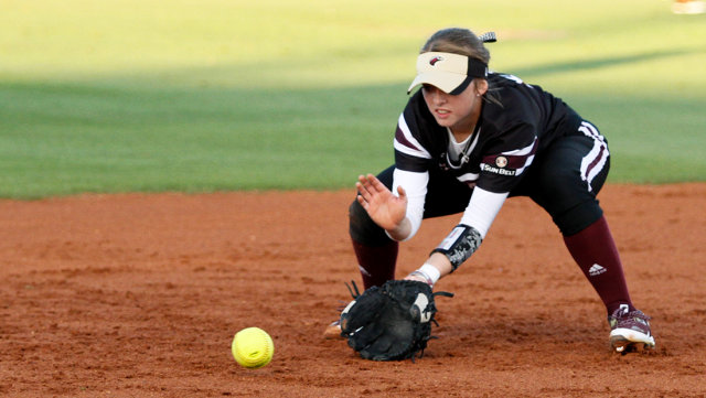 Third+baseman+Megan+Shaw+looks+to+field+a+groundball+and+make+the+long+throw+to+first+base+during+Saturday%E2%80%99s+game+against+the+Mountaineers.+