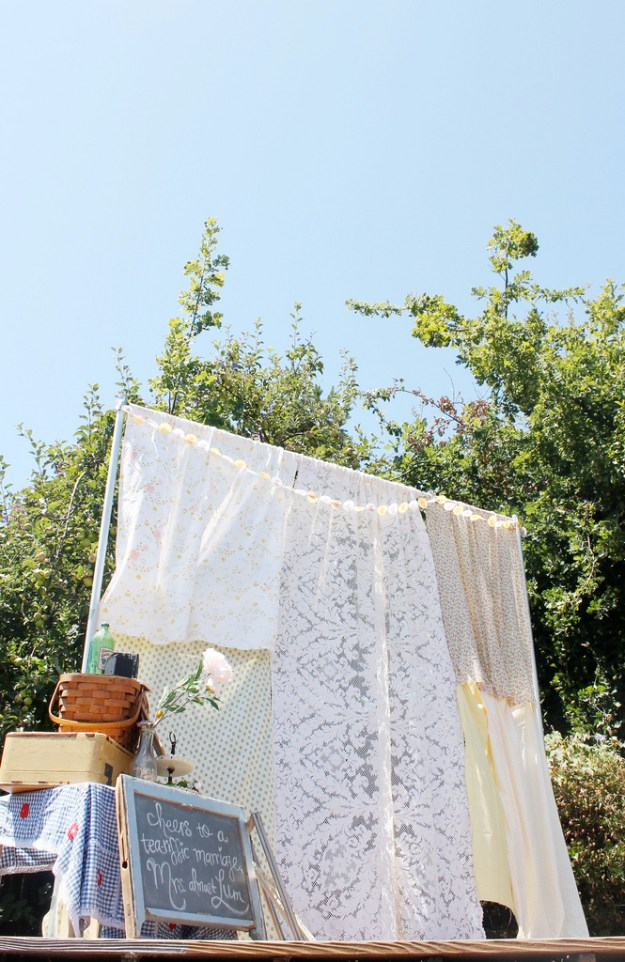 a photobooth with linen tablecloths
