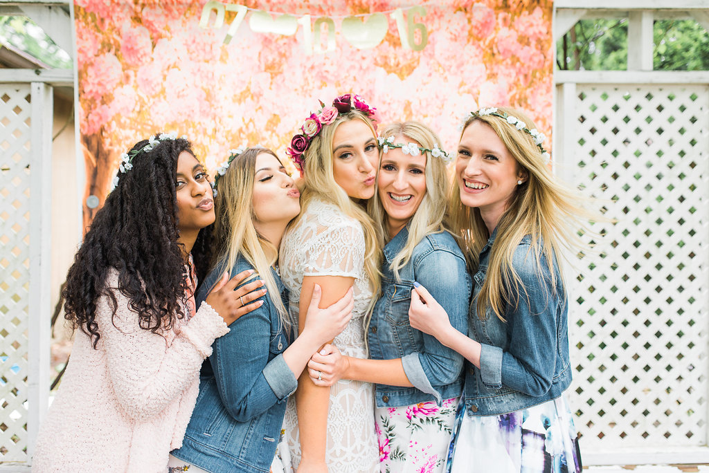 031844bd974a ... Garden bridal shower photo booth with the bride in a stunning lace bridal  shower dress and ...