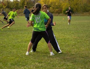 Lady forcing ultimate frisbee