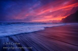 Iceland sunset on beach by jack graham