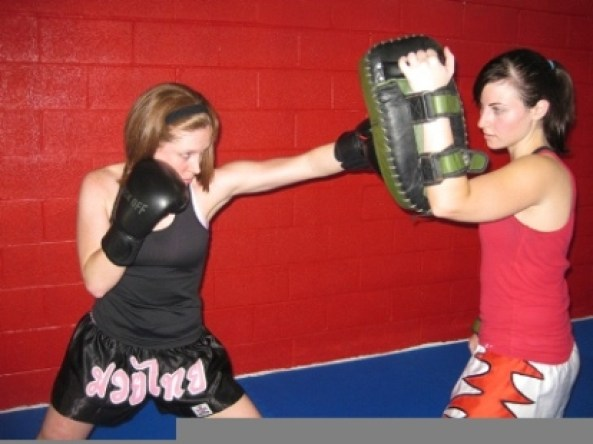 Ultimate Martial Arts jab strike to pads womens class
