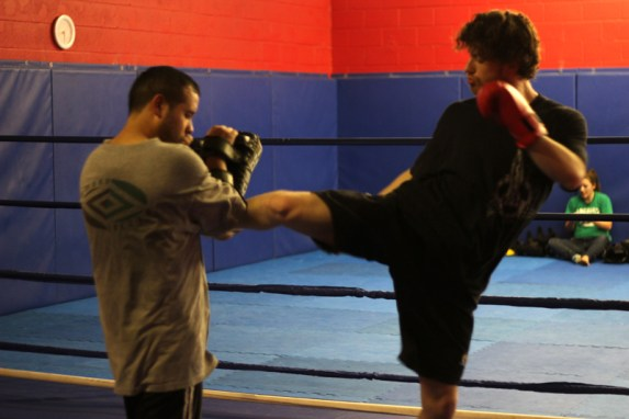 ultimate_martial_arts_swing_kick_to_pads