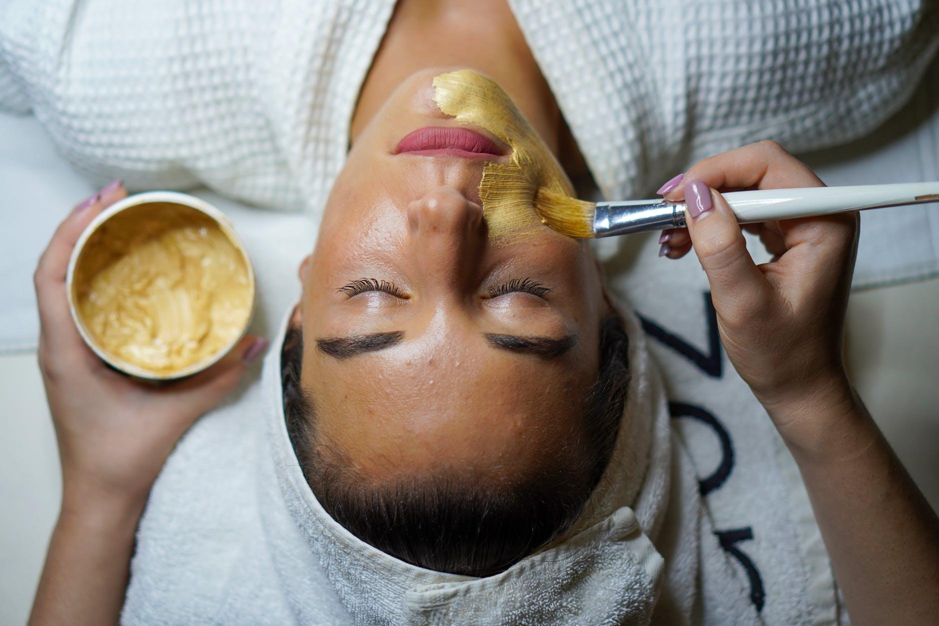 woman doing facial mask