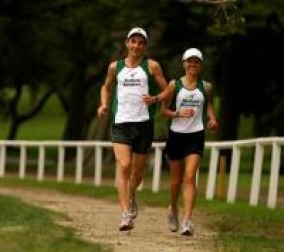 Chris running with his wife, Greta in Centennial Park