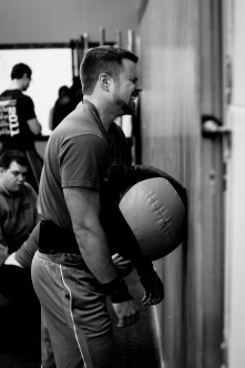 An athlete feeling the burn of the wall-balls