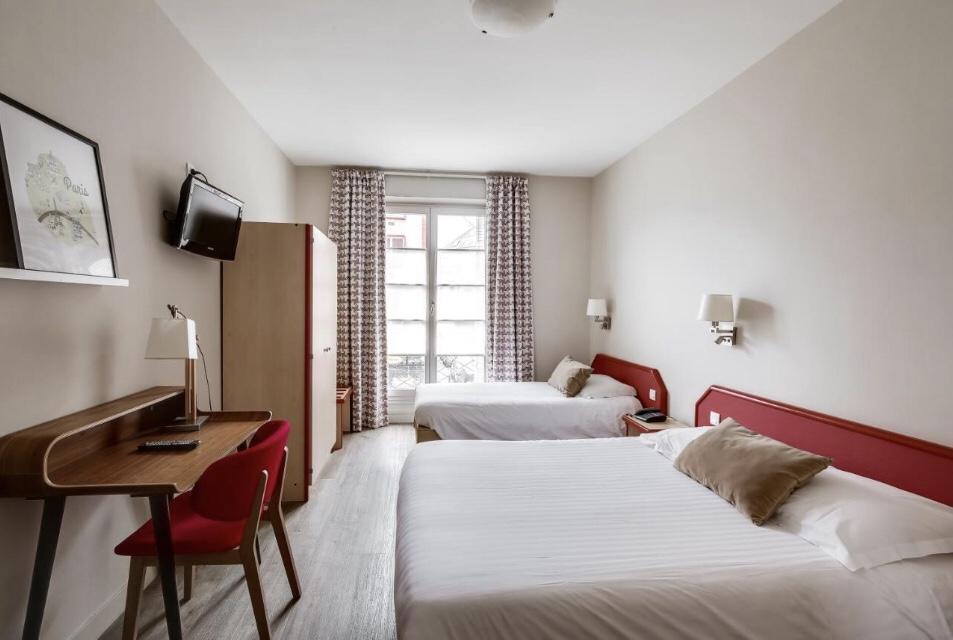 Quarto do Hôtel Marguerite | Foto: Booking