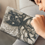 Notebook with all-over graphic design, adapted from the artist's charcoal drawing.