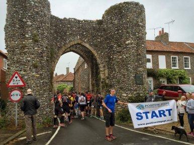 Start of Norfolk 100 under Castle Acre Bailey Gate