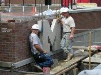 Masons installing the M