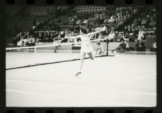 Billie Jean King lunges for ball