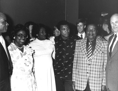 Ali with the parents of Owen Brown on his left and right.