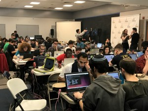 Coders focus on their programs Saturday, Feb. 18 at the JHacks Hackathon.