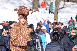 """""""I pretty much woke up, trying to eat my leaves on the branch, but they were frozen so I said dang I'm going to try my luck out here. But then I realized I'm a giraffe and have no thumbs so I couldn't throw a snowball. I'm just trying to do the best I can."""" - Nathan Markovitz, junior criminal justice major. (Julia Keane/Bloc Photographer)"""