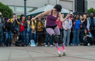 """Camille Morin, aka Camilla the Hun, during the """"Birth of a City"""" Roller Disco Performance curated and choreographed by rollerskating activist Holly Bass. Camille is a retired D.C. Roller Girl. (Cassie Osvatics/Bloc Reporter)"""