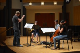 """Players perform """"Atrophied Signals"""" by Chris Newman. Pictured: Erika Binsley, ; Sean McFarland, age 24 from Baltimore, MD; Preet Saund, junior cello performance major. (Emma Riley/Bloc Photographer)"""