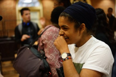 Jagjot Kaur, laughing as she is being complimented on her spoken word piece. (Heather Kim/Bloc Photographer)