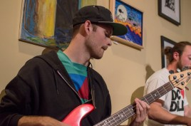 Bassist, Logan Nyman, of Box Era during their feature performance at the Board and Brew open mic. Nyman is a former student of this university. Pictured in back, drummer Mitch Faulkner. (Cassie Osvatics/Bloc Reporter)