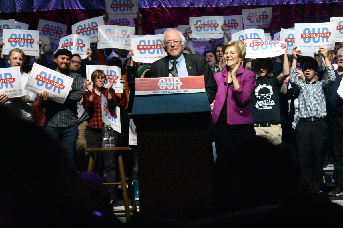 Senators Sanders and Warren standing side-by-side